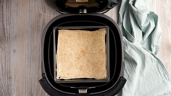 Pie crust in a glass baking dish placed in an Air Fryer